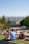 Tourists admire view from Montmartre in Paris France in May 2008