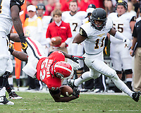 The Georgia Bulldogs beat the App State Mountaineers 45-6 in their homecoming game.  After a close first half, UGA scored 31 unanswered points in the second half.  Georgia Bulldogs linebacker Amarlo Herrera (52) is tackled after his interception resulting in a fumble recovered by Appalachian State