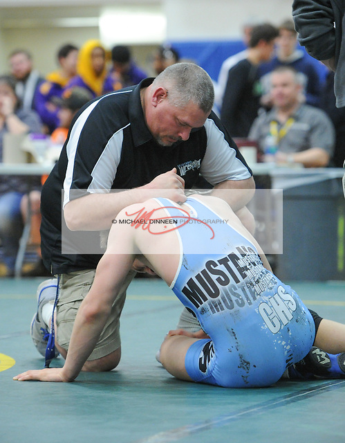 Chugiak's Dawson Budke is consoled by coach  blah blah after a knee injury forced him out of the 160 lb. finals match with South's Rami Pullumbi during the   state championships at Bartlett High School. Budke lost by injury. Photo for the Star by Michael Dinneen
