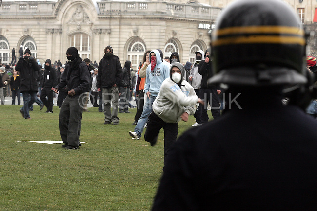 """© REMI OCHLIK/IP3; PARIS, FRANCE LE 23/03/06 - MANIFESTATION CONTRE LE CPE - HEURTS ENTRE FORCE DE L ORDRE ET POLICIERS - PLACE DES INVALIDES....The contrat premiere embauche (CPE), translated first employment contract, was a new form of employment contract pushed in spring 2006 in France by Prime Minister Dominique de Villepin. This employment contract, available solely to employees under 26, would have made it easier for the employer to fire employees by removing the need to provide reasons for dismissal for an initial """"trial period"""" of two years, in exchange for some financial guarantees for employees. ....The law has met heavy resistance from students, trade unions, and left-wing activists, sparking protests in February and March 2006 (and continuing into April) with hundreds of thousands of participants in over 180 cities and towns across France"""