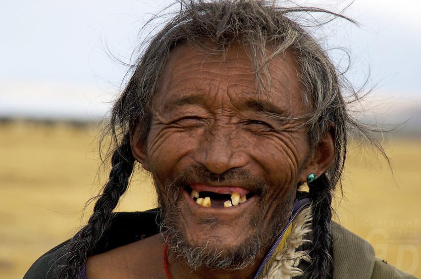 78 year old Tibetan Nomad near Lake Namtso 78 year old Tibetan Nomad near Lake Namtso at an altitude of 4800 meters.
