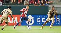 Chivas USA midfielder Gerson Mayen (14) moves between Philadelphia Union players Amobi Okugo (14) and Michael Orozco Fiscal (16) during the second half of the game between Chivas USA and the Philadelphia Union at the Home Depot Center in Carson, CA, on July 3, 2010. Chivas USA 1, Philadelphia Union 1.