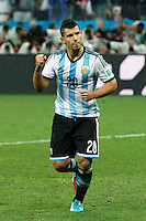Sergio Aguero of Argentina celebrates scoring his penalty