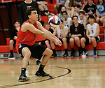 Cheshire, CT- 18 May 2017-051817CM08-  <br /> Cheshire's Mitch Manware bumps the ball during their SCC volleyball matchup against Xavier on Thursday.  Christopher Massa Republican-American