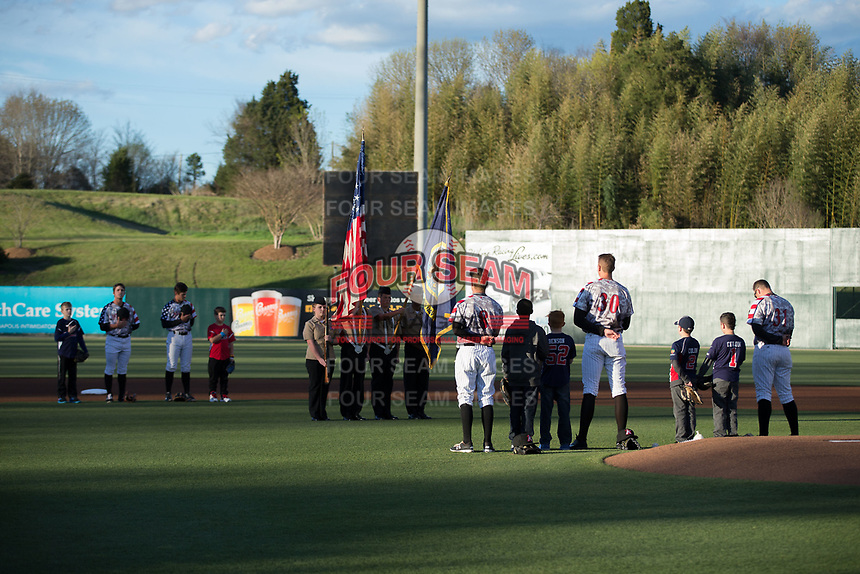 The Kannapolis Intimidators face the Color Guard during the National Anthem on Military Appreciation Night prior to the game against the Lakewood BlueClaws at Kannapolis Intimidators Stadium on April 7, 2017 in Kannapolis, North Carolina.  The BlueClaws defeated the Intimidators 6-4.  (Brian Westerholt/Four Seam Images)