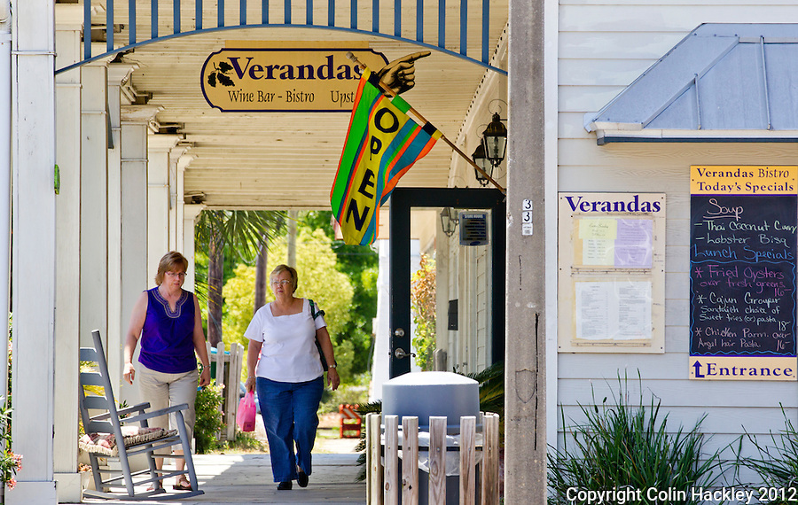 Visitors walk by Verandas one of 14 places to eat in Apalachicola..COLIN HACKLEY PHOTO