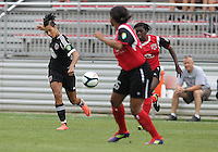 BOYDS, MARYLAND - July 21, 2012:  Lianne Sanderson (10) of DC United Women slots a pass between Victoria Jhnson (26) and Stephanie Goddard (21) of the Virginia Beach Piranhas during a W League Eastern Conference Championship semi final match at Maryland Soccerplex, in Boyds, Maryland on July 21. DC United Women won 3-0.