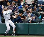 Seattle Marines' right fielder Ichiro Suzuki catches a ball hit by Boston Red Soxs' Kevin Millar along the first base line in the second inning of their American league game at Safeco Field in Seattle, Washington on Sunday, 15 May 2005. Jim Bryant Photo. ©2010. ALL RIGHTS RESERVED.