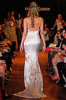 Model walks the runway in a Luxe wedding dress - hand painted bateau nexk silk crepe back satin gown, by Sarah Jassir, for the Sarah Jassir Couture Bridal Fall 2012 Opulence collection.