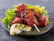 Chicken Tikka with salad & naan bread.