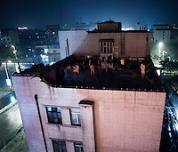 People on the roof of a high rise building in central Jiexiu.