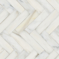 "Herringbone 3"" x 12"", a hand-cut stone mosaic, shown in polished in Calacatta Tia."