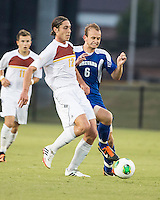 Winthrop University Eagles vs the Brevard College Tornados at Eagle's Field in Rock Hill, SC.  The Eagles beat the Tornados 6-0.  Adam Brundle (12) and Ryan Vandenberg (6) challenge for the ball.