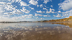 Panorama of the beach at Compton with cumulus clouds Reflected on the wet sand