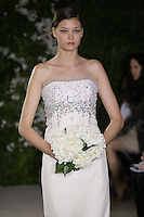 Model walks runway in a Diana wedding dresses by Carolina Herrera, for the Carolina Herrera Bridal Spring 2012 runway show.