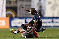 Fabio Alves (Fabinho) (33) of the Philadelphia Union goes over the top of Mark Bloom (28) of Toronto FC. The Philadelphia Union defeated Toronto FC 1-0 during a Major League Soccer (MLS) match at PPL Park in Chester, PA, on October 5, 2013.