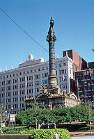 Cleveland: Soldiers and Sailors Monument, 1895. A square building with a 120 ft. shaft, and Miss Liberty behind it. May Co. building & clock. Photo '01.
