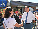 Bellmore, New York, U.S. 22nd September 2013. Former Nassau County Executive TOM SUOZZI (Democrat), who is running for his former office again, shakes hand with a woman during his campaign stop to the 27th Annual Bellmore Family Street Festival, featuring family fun with exhibits and attractions in a 25 square block area, with over 120,000 people expected to attend over the weekend.