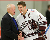 Longtime Army coach and father of Army's current coach Jack Riley speaks to Brian Day (Colgate - 12) prior to dropping the puck. - The host Colgate University Raiders defeated the Army Black Knights 3-1 in the first Cape Cod Classic at the Hyannis Youth and Community Center in Hyannis, MA.