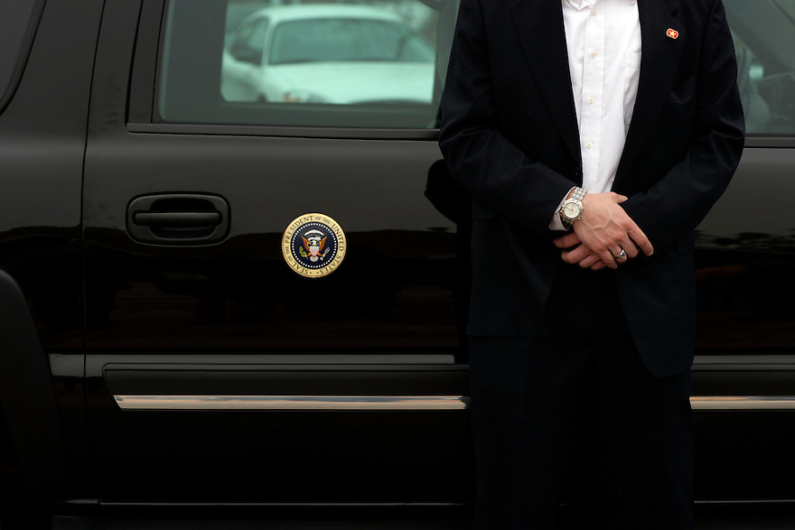 A Secret Service agent stands guard in front of President George W Bush's vehicle, while he tours rebuilding efforts in a neighborhood affected by Hurricane Katrina, Thursday, March 1, 2007 in Long Beach, Miss. .Photo by Brooks Kraft/Corbis......