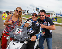 Aug 19, 2016; Brainerd, MN, USA; Papa Johns pizza founder John Schnatter (right) with NHRA funny car driver John Force (center) and top fuel driver Leah Pritchett during qualifying for the Lucas Oil Nationals at Brainerd International Raceway. Mandatory Credit: Mark J. Rebilas-USA TODAY Sports