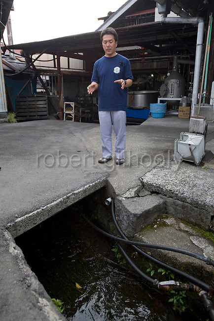 Shinichi Sei, president of Fuji-nishiki Sake Brewery explains about the water used in the sake brewing process at his brewery in Fujinomiya, Shizuoka Prefecture Japan on 02 Oct. 2012.  Photographer: Robert Gilhooly