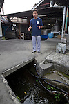 Shinichi Sei, president of Fuji-nishiki Sake Brewery explains about the water used in the sake brewing process at his brewery in Fujinomiya, Shizuoka Prefecture Japan on 02 Oct. 2012.  Photographer: Robert Gilhooly