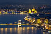Sunset over the Szechenyi Chain Bridge and Parliament Building seen from Citadella in Budapest, Hungary