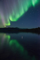 Northern lights reflect in lake Sitojaure outside of Sitojaure hut, Kungsleden trail, Lapland, Sweden
