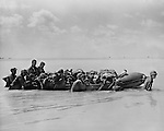 Marines wounded in the landing on Tarawa are towed out to a larger craft on a rubber landing boat by their comrades. The larger vessels then took them to base hospitals for treatment.