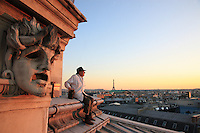 .Paris, Opera Garnier. Jean Paucton, 76 years old, set up his hives twenty years ago on the roof of the Opera just by chance. A prop man at the opera, he took courses in beekeeping at the Société Centrale for apiculture in the Luxembourg gardens. Sharing his time between Paris and the Creuse, he didn't know what to do with a hive given to him by a friend. It was the Opera fireman, who himself bred fish in the underground pond beneath the opera, who gave him the idea of setting the bees up on the roof of the Garnier..
