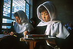 Afghan girls, denied an education under the Taliban, study in a school for refugee children in Quetta, Pakistan.