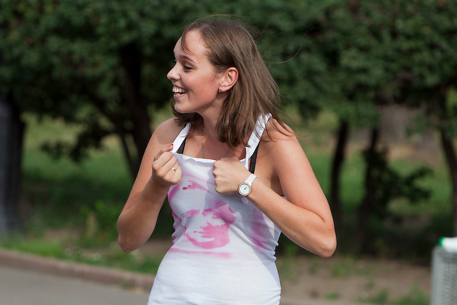 "Moscow Russia, 23/07/2011..A young woman tears her shirt with a with a spray-painted image of Prime Minister Vladimir Putin, as members of Putin's Army, a group of Pro-Putin activists that launched on the Internet last week with a video of scantily clad young Russian women, campaign in central Moscow under the slogan ""Tear Something For Putin""."