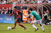 Edgar Castillo (2) of the United States  is defended by Efrain Juarez (16) of Mexico during an international friendly between the men's national teams of the United States (USA) and Mexico (MEX) at Lincoln Financial Field in Philadelphia, PA, on August 10, 2011.