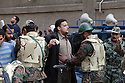 """Protesters are searched by the Egyptian military as they enter a """"million man march"""" demonstration February 01, 2011 in Central Cairo's Tahrir, or """"Liberation"""" square. The march capped a week of protests that are threatening to bring down the nearly 30 year old regime of Hosni Mubarak."""