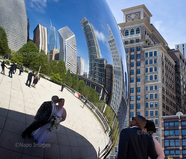 """CHICAGO, ILLINOIS, USA 22 APRIL, 2012:.Newlyweds are looking at their reflection by the famous """"Bean"""" sculpture in Millenium Park in centre of the town..(Photo by Piotr Malecki / Napo Images)..CHICAGO, ILLINOIS, USA 22/04,2012:.Nowozency przegladaja sie w powierzchni slawnej rzezby """"bean"""" (fasolka) w Millenium Park w centrum miasta..Fot: Piotr Malecki / Napo Images"""