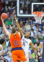 Mike Muscala of the Bison shoots over Huskies' Charles Okwandu. Connecticut defeated Bucknell 81-52 during the NCAA tournament at the Verizon Center in Washington, D.C. on Thursday, March 17, 2011. Alan P. Santos/DC Sports Box