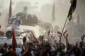 Punjab, Pakistan<br /> November 12, 1988<br /> <br /> Benazir Bhutto drives through a small village in the Punjab province during her campaign for Prime Miinister.<br /> <br /> Benazir Bhutto is the eldest child of former Pakistan President and Prime Minister Zulfikar Ali Bhutto. She found herself placed under house arrest in the wake of her father's imprisonment and subsequent execution in 1979. In 1984 she became the leader in exile of the Pakistan Peoples Party (PPP), her father's party, though she was unable to make her political presence felt in Pakistan until after the death of General Muhammad Zia-ul-Haq. <br /> <br /> On 16 November 1988 Benazir's PPP won the largest bloc of seats in the National Assembly. Bhutto was sworn in as Prime Minister in December, at age 35 she became the first woman to head the government of a Muslim-majority state in modern times. <br /> <br /> She was removed from office 20 months later under orders of then-president Ghulam Ishaq Khan for alleged corruption. Bhutto was re-elected in 1993 but was again removed by President Farooq Leghari in 1996, on similar charges. Bhutto went into self-imposed exile in Dubai in 1998, until she returned to Pakistan on October 2007, after General Musharraf granted her amnesty and all corruption charges withdrawn.