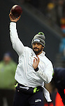 Seattle Seahawks quarterback Russell Wilson warms up before their game against Carolina Panthers in the NFC Western Division Playoffs at CenturyLink Field in Seattle, Washington on January 10, 2015.   The Seahawks beat the Panthers 31-17. ©2015. Jim Bryant Photo. All Rights Reserved.
