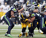 Seattle Seahawks linebackers Mike Morgan (57), Bobby Wagner (54) and defensive end Michael Bennett (72) gang tackle Pittsburgh Steelers running back DeAngelo Williams (34) at CenturyLink Field in Seattle, Washington on November 29, 2015.  The Seahawks beat the Steelers 39-30.      ©2015. Jim Bryant Photo. All Rights Reserved.