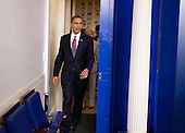 United States President Barack Obama arrives to make a statement about rules requiring employers to provide contraceptions for employees in the briefing room of the White House in Washington, DC, on February 10 2012. The compromise is directed at the concerns of religious organizations, who claim providing contraceptions violates their religious beliefs.  .Credit: Joshua Roberts / Pool via CNP