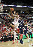 Ohio State's Lenzelle Smith, Jr. (32) drives to the basket past North Florida's Travis Wallace (1) during the second half Friday, Nov. 29, 2013, in Columbus, Ohio. (Photo by Terry Gilliam)