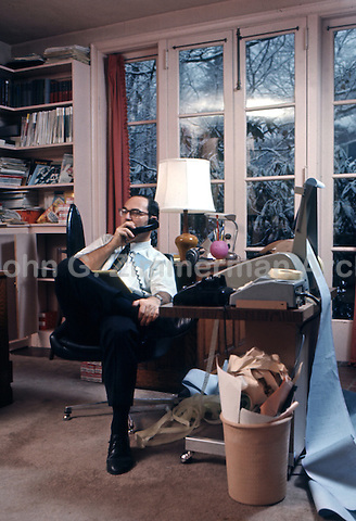 Businessman works at home computer, 1970. The computer system, known as 'time-sharing,' consisted of a teletype terminal connected to a big central unit via telephone. Photo by John G. Zimmerman.