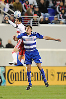 Juan Pablo Angel (9) of the New York Red Bulls and George John (14) of FC Dallas go up for a header. The New York Red Bulls defeated FC Dallas 2-1 during a Major League Soccer (MLS) match at Red Bull Arena in Harrison, NJ, on April 17, 2010.