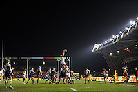 Matt Garvey of Bath Rugby rises high to win lineout ball. Aviva Premiership match, between Harlequins and Bath Rugby on March 11, 2016 at the Twickenham Stoop in London, England. Photo by: Patrick Khachfe / Onside Images