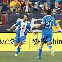 Philadelphia Union midfielder Daniel Cruz (44) celebrates his goal with teammates.  In a Major League Soccer (MLS) match, the New England Revolution (dark blue) defeated Philadelphia Union (light blue), 5-1, at Gillette Stadium on August 25, 2013.