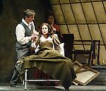2002 - LA BOHEME - Rodolfo (Misha Didyk) comforts a dying Mimi (Robin Follman) as Musetta (Anita Johnson) looks on in Opera Pacific's production of La Boheme.