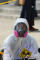 April 10, 2011 - A man wearing a gas mask and boiler suit prepares before a Anti- Nuclear protest in Koenji, Tokyo, Japan..According to the organisers 15,000 attended the protest more conservative estimates put the number at 5000. (Photo by B.Meyer-Kenny/2.0 images)