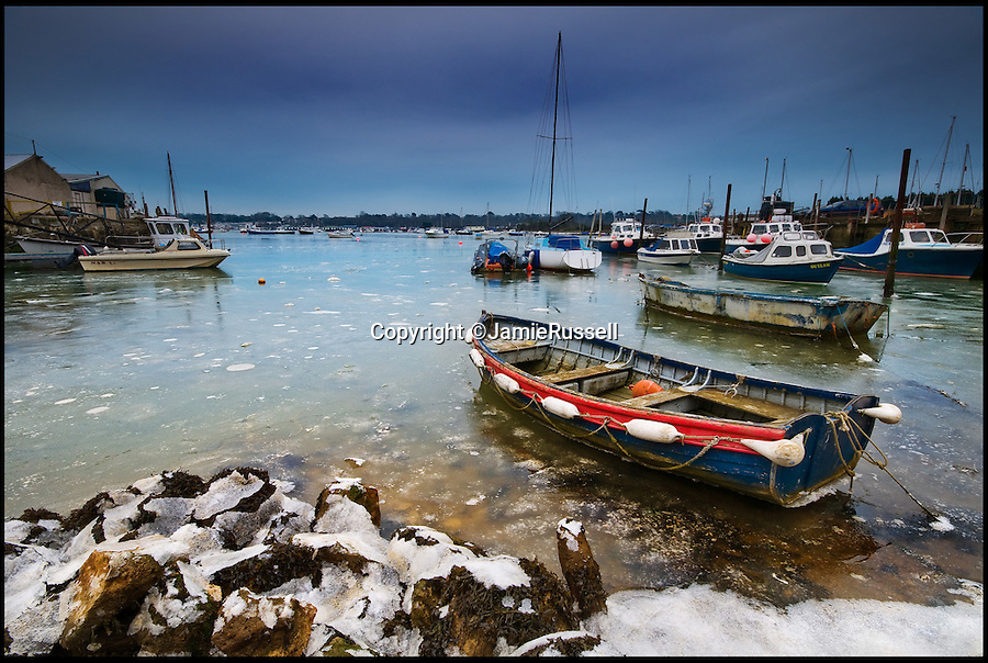 BNPS.co.uk (01202 558833)<br /> Pic: JamieRussell/BNPS<br /> <br /> ***Please Use Full Byline***<br /> <br /> A boat is ice locked at Bembridge Harbour.<br /> <br /> Stunning photographs have revealed a turbulent side to the normally genteel Isle of Wight.<br /> <br /> The seemingly benign south coast holiday destination has been catalogued over a stormy year by local photographer Jamie Russell, and his astonishing pictures reveal the dramatic changes in weather that roll across the UK in just 12 months.<br /> <br /> Lightning storms, ice, floods, gales and blizzards have all been captured by the intrepid photographer who frequently got up in the middle of the night to capture the climatic chaos.<br /> <br /> Looking at these pictures prospective holidaymakers could be forgiven for thinking twice about a gentle staycation on the south coast island.