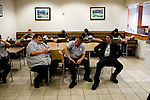Civilian staff of the Fort Carson dining facility take a break following the post's lunch hour...Major General Mark Graham and his wife, Carol, talk about the deaths of their two sons in their Fort Carson home in Colorado Springs, Colo.  Their son, Second Lt. Jeff Graham was killed by a roadside bomb in Iraq just months after their other son, ROTC Cadet Kevin Graham, committed suicide in his apartment.  Since Kevin's suicide, the Grahams have been outspoken advocates for suicide prevention.